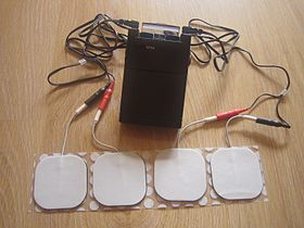 A TENS unit (transcutaneous electrical nerve stimulation unit or TNS)